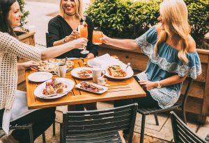 Three diners on Osteria Via Stato's Patio