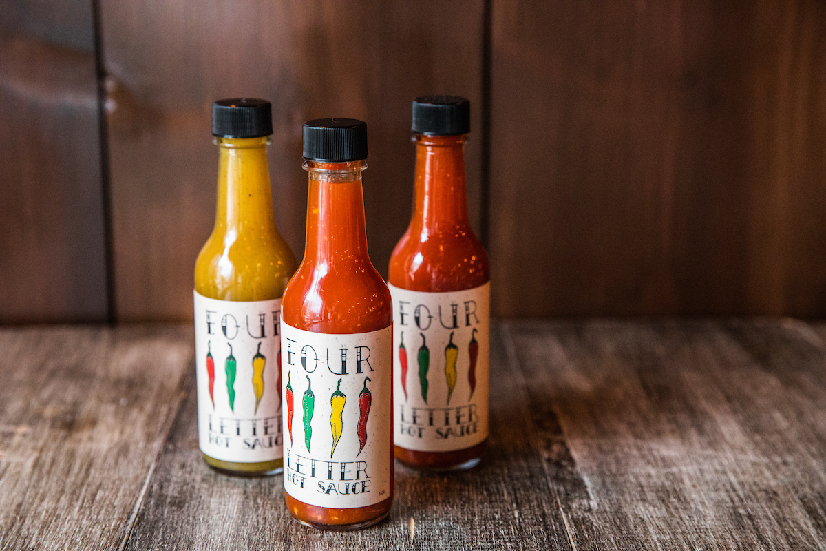 3 different types of hot sauce in bottles