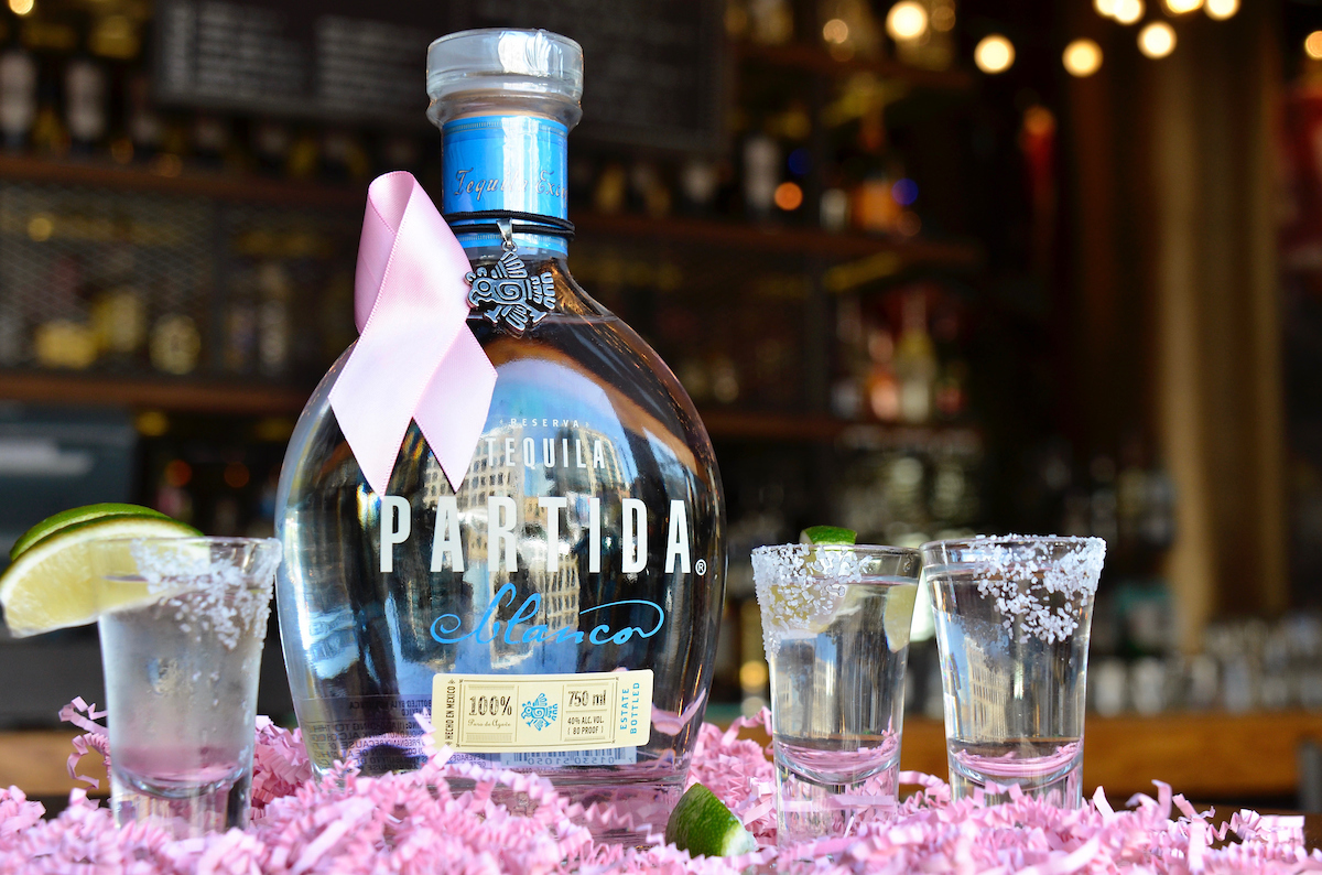 bottle of Partida Tequila with pink ribbons