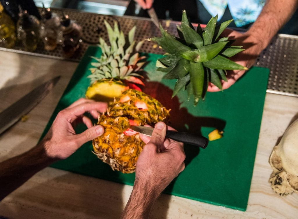 Garnishes being created from a pineapple