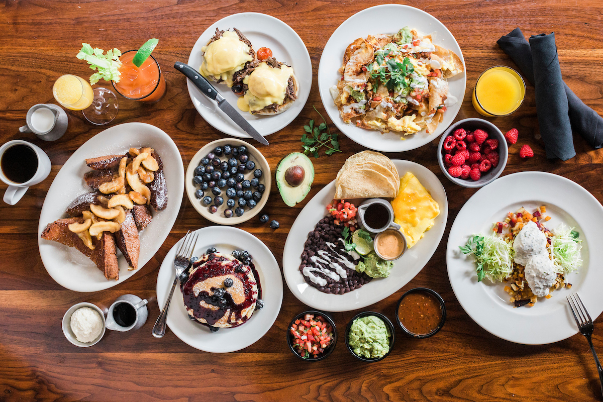 Hub 51 brunch dishes including breakfast tacos, breakfast nachos, pancakes, benedicts and more