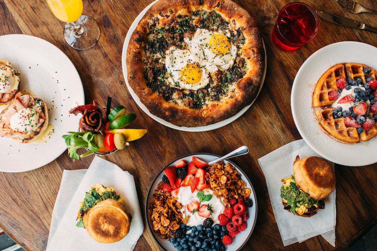 Brunch pizza, yogurt parfait, waffles and bloody mary