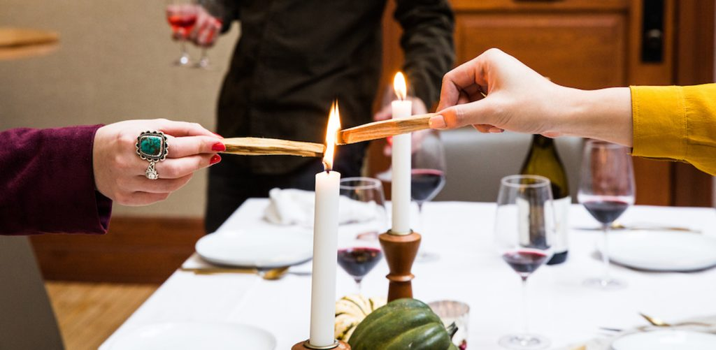 friends burning spiritual wood over a candle