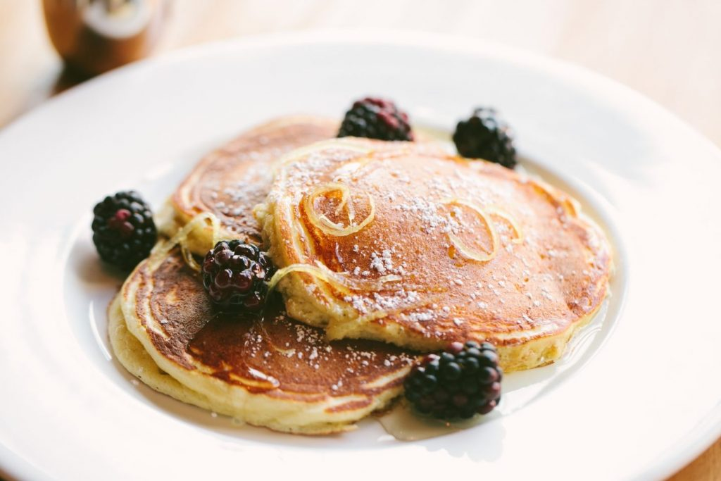 Beatrix's Light & Fluffy Lemon Pancakes with blackberries and lemon syrup