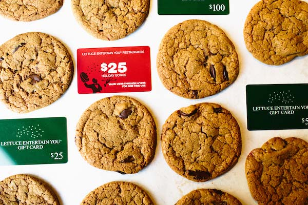 chocolate chip cookies with gift cards surrounding them