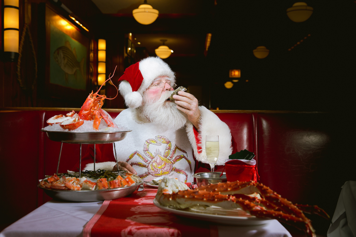 santa eating oysters in a booth at Shaw's