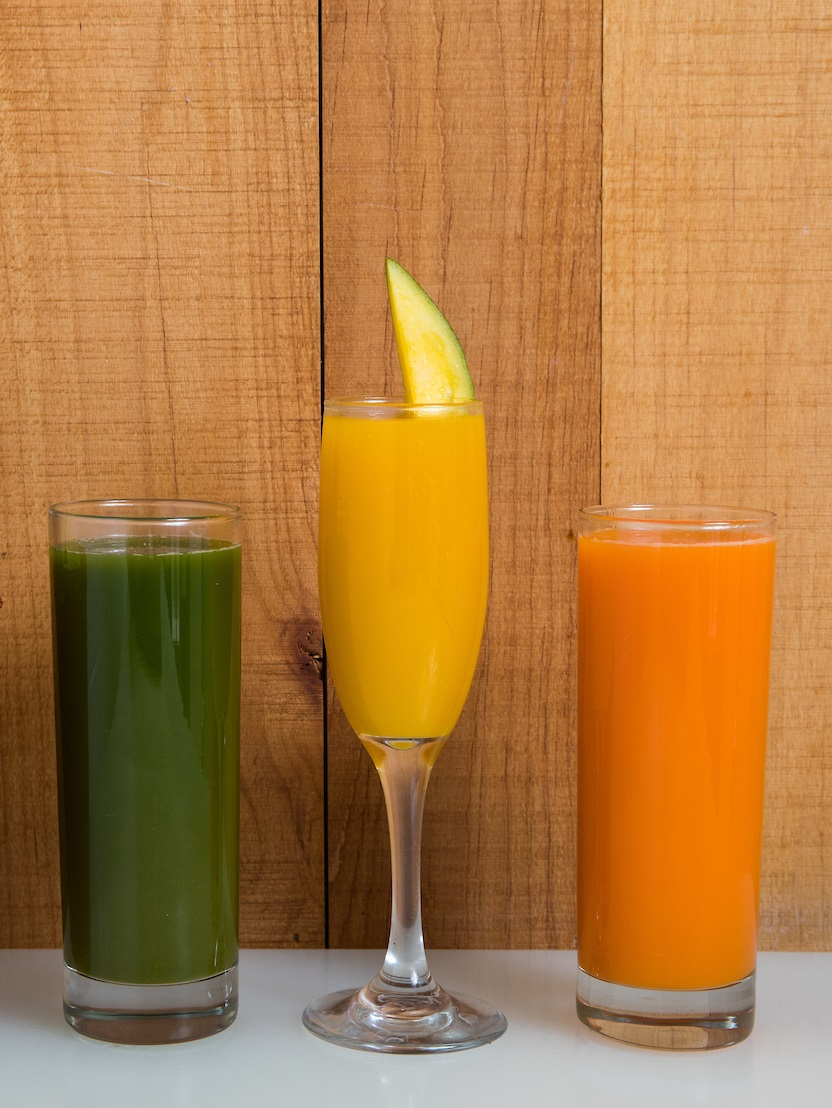 three drinks: green juice, mimosa, orange juice