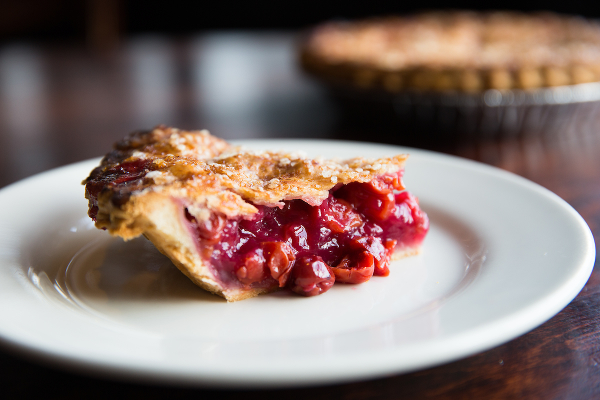 slice of cherry pie on a plate from wildfire