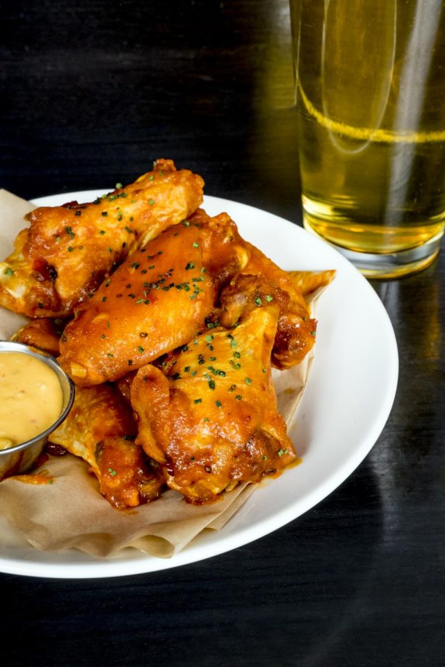wings from stella barra with a beer next to it
