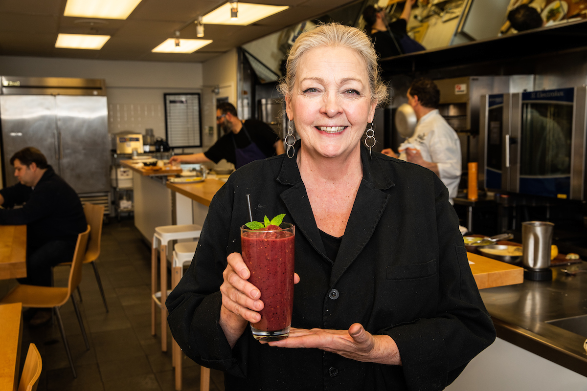 Chef Rita holding the smoothie