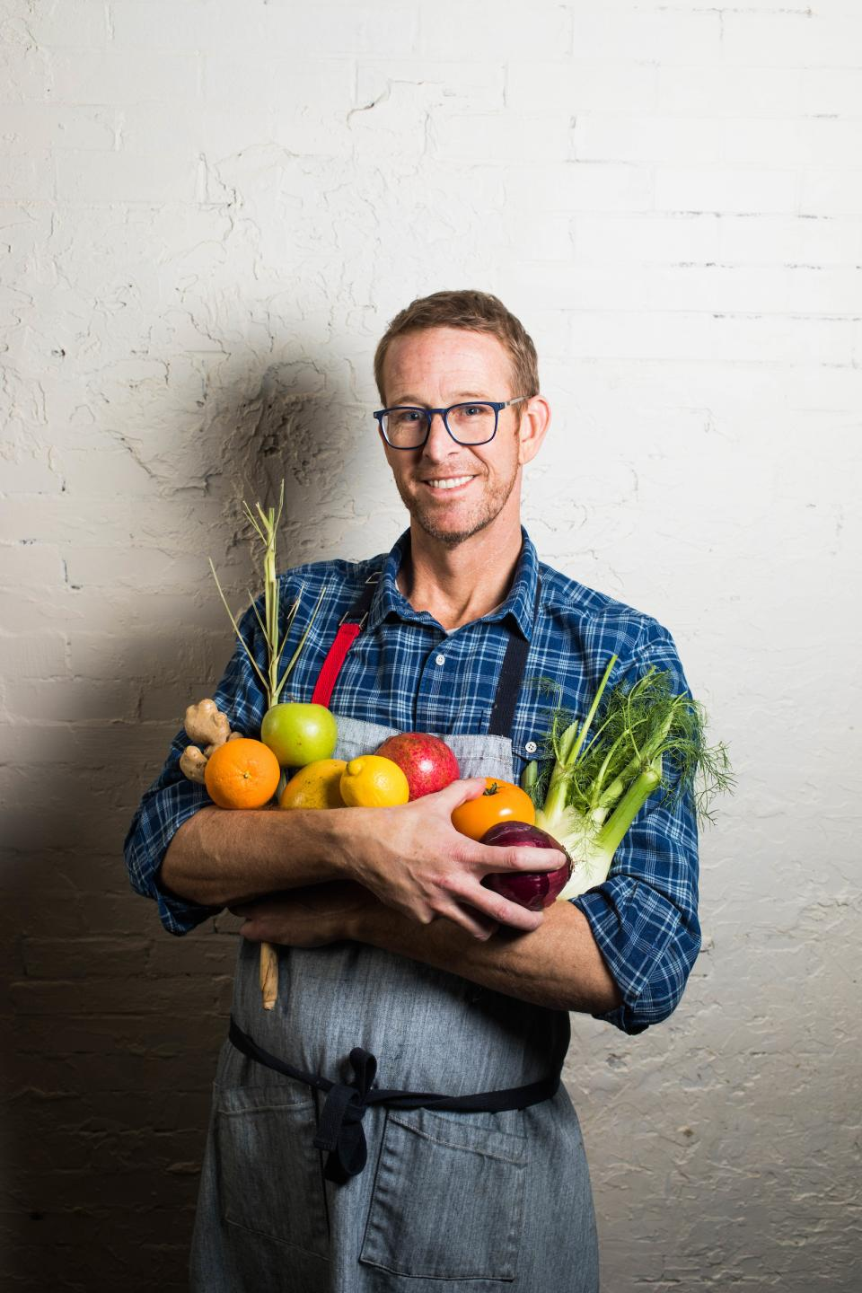 Chef CJ Jacobson holding vegetables