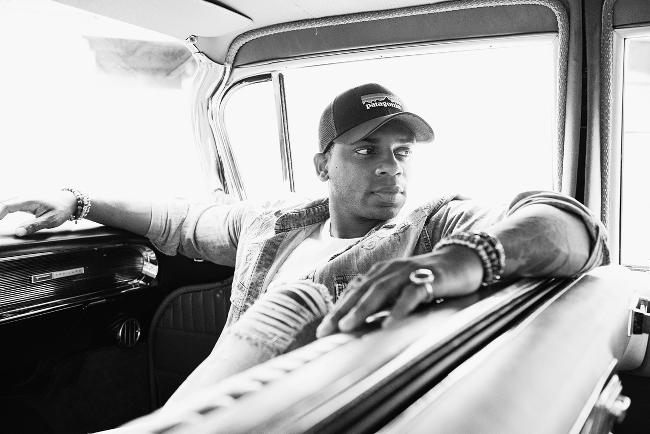 Jimmie Allen wearing a black hat in a car
