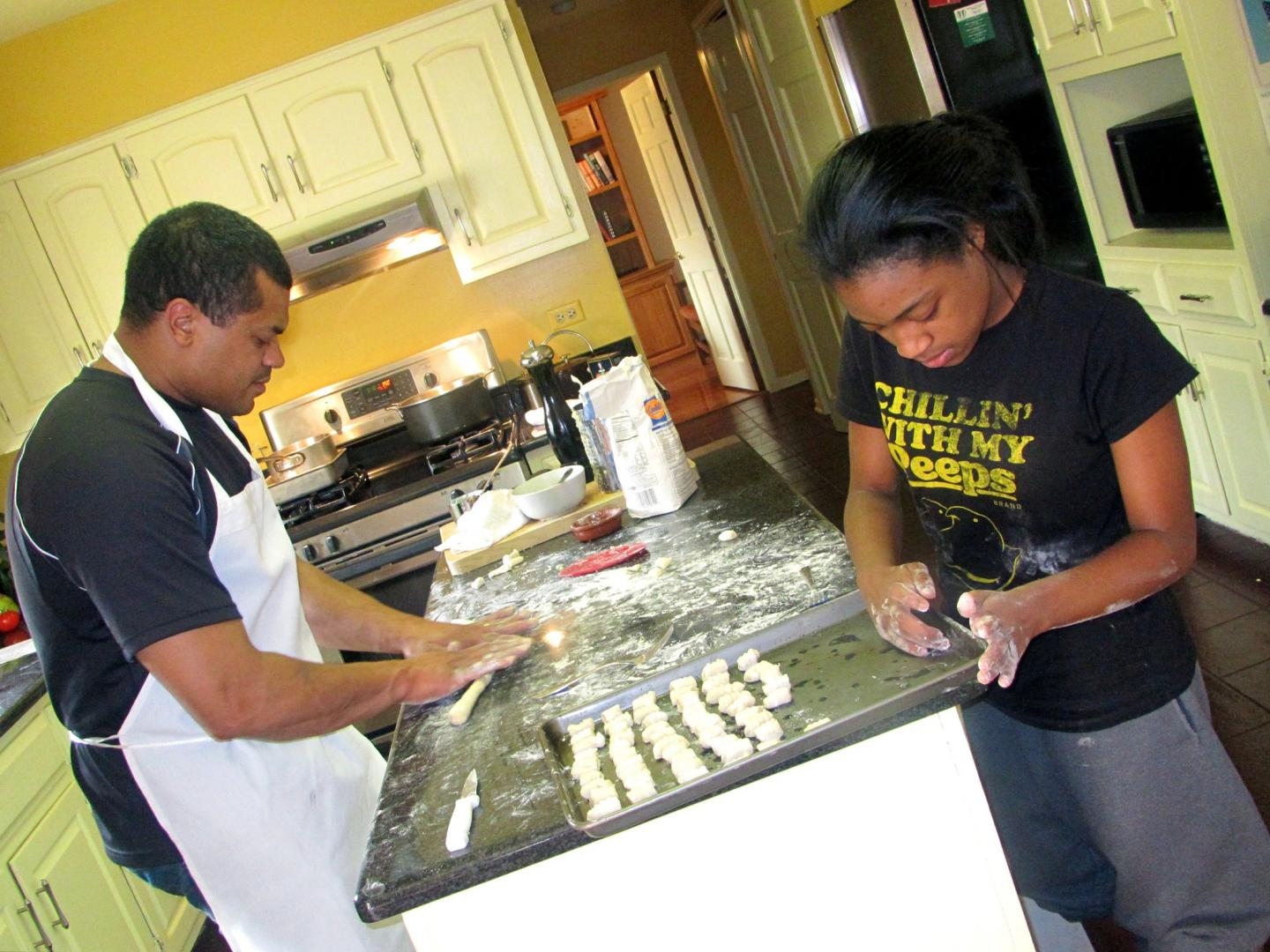 Chef Mychael and his daughter cooking