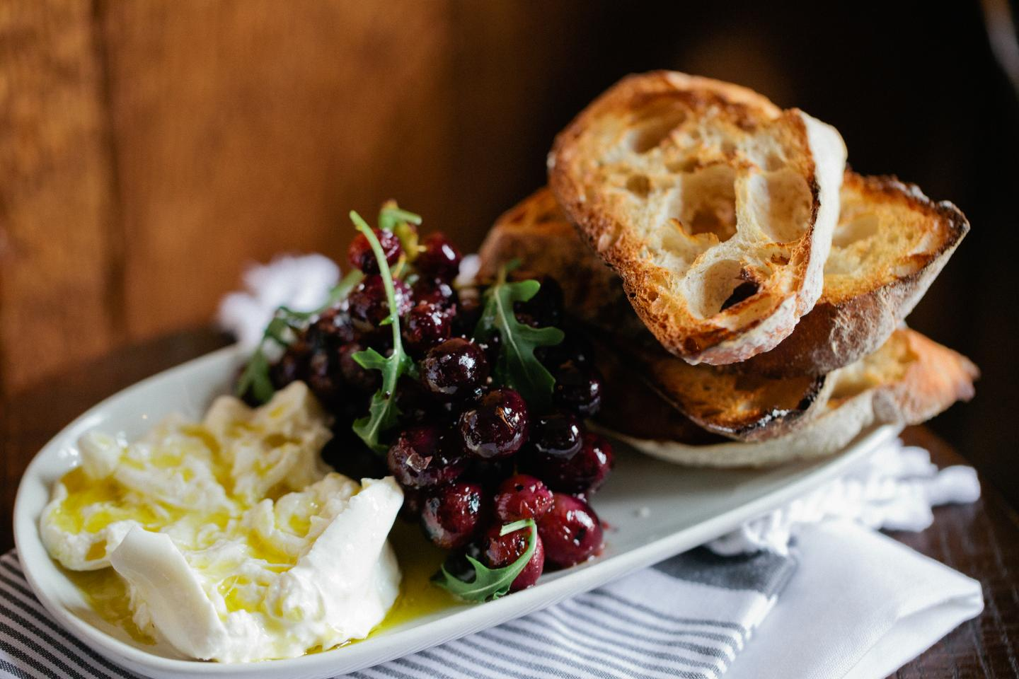 burrata and grilled grapes with bread from stella barra