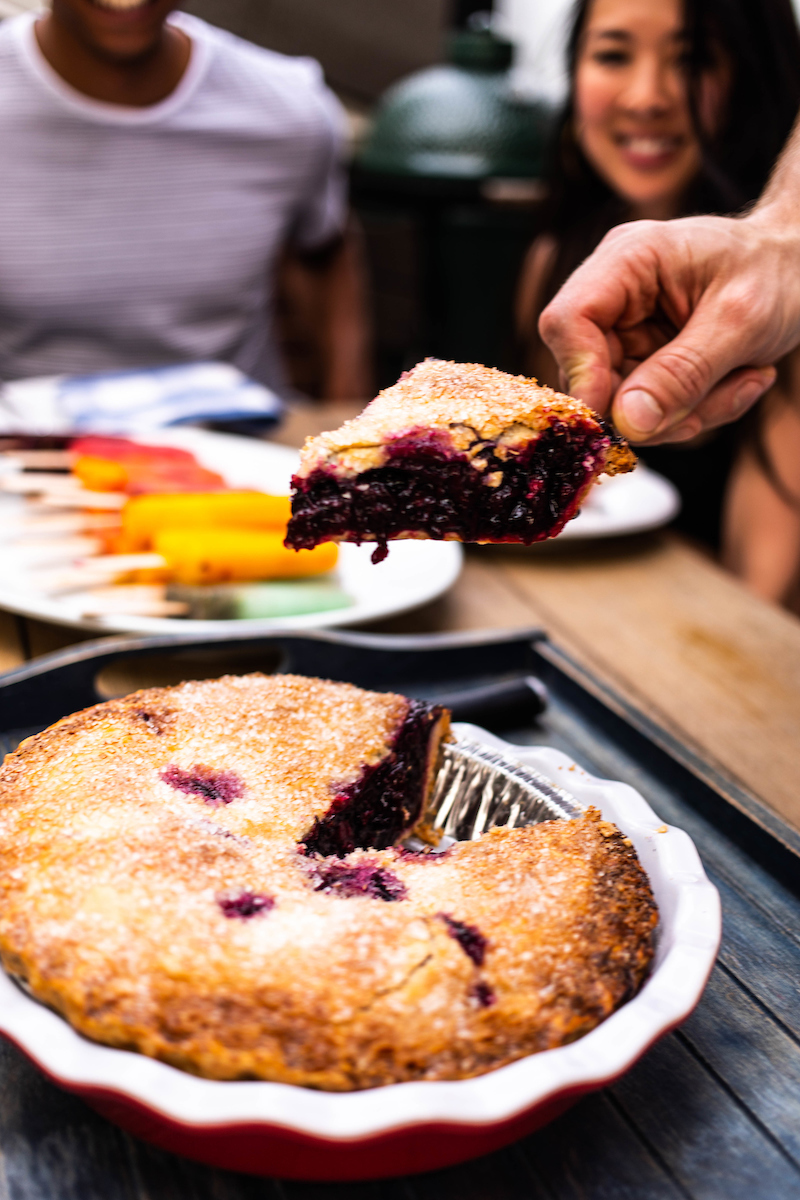 cutting blueberry pie