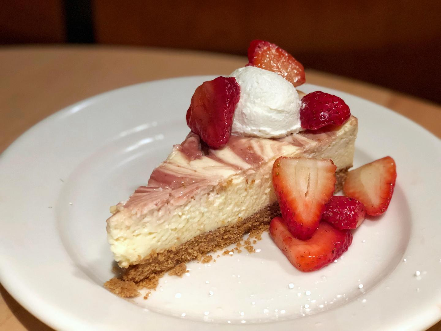 Slice of cheesecake with strawberries from Mity Nice in Water Tower Place