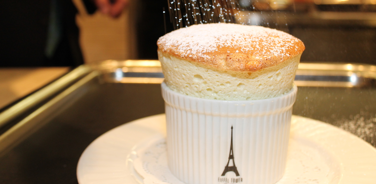 Eiffel Tower Souffle being topped with powdered sugar