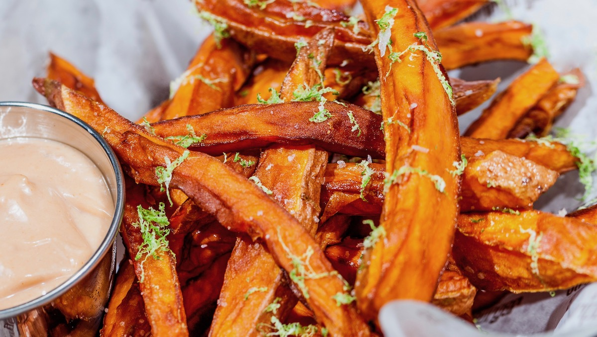 Fresh cut sweet potato fries dusted with herbs and served with chili mayo sauce at Stripburger and Chicken in Las Vegas.