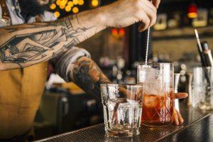 Bartender stirring a Negroni