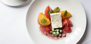 local summer tomatoes on a plate at Taste of Lettuce