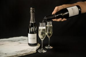 Bottle of Guiliana Prosecco being poured into flutes