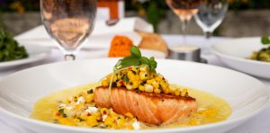 salmon with corn on a plate