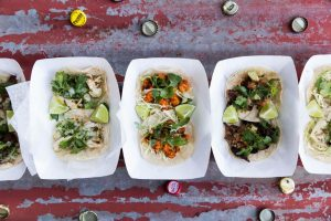 Tacos on a table with bottlecaps
