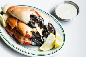 Stone crab claws at Joe's on a plate