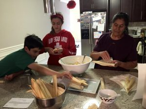Family making tamales - holiday food traditions