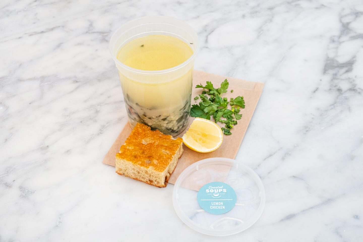 Lemon Chicken Soup with pearl couscous, herbs;