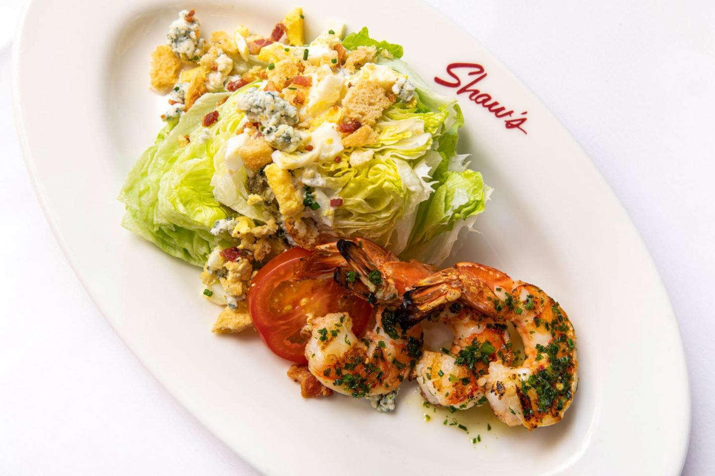 wedge salad with grilled shrimp at Shaw's Crab house lunch