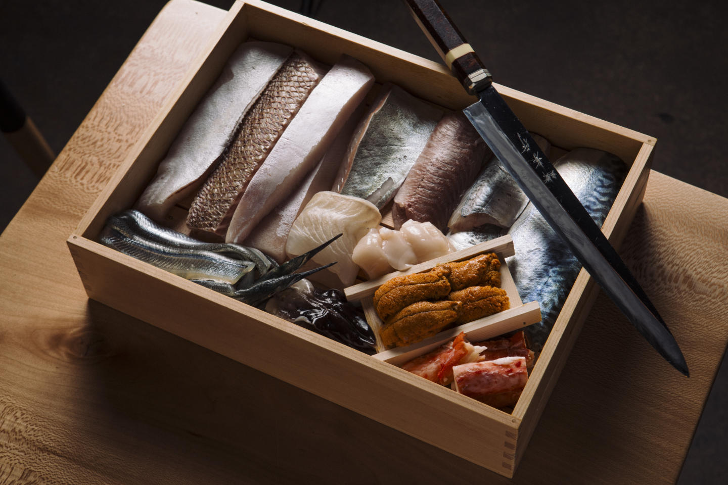 raw fish and ingredients for the sushi san omakase