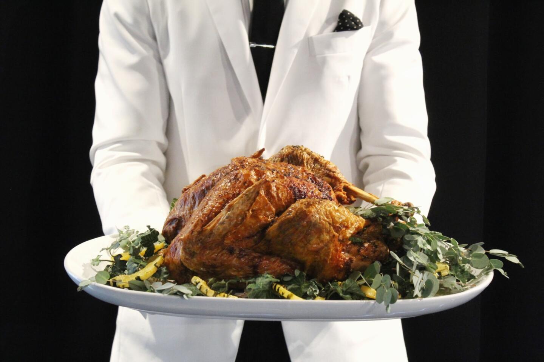 RPM Steak server with Thanksgiving Turkey