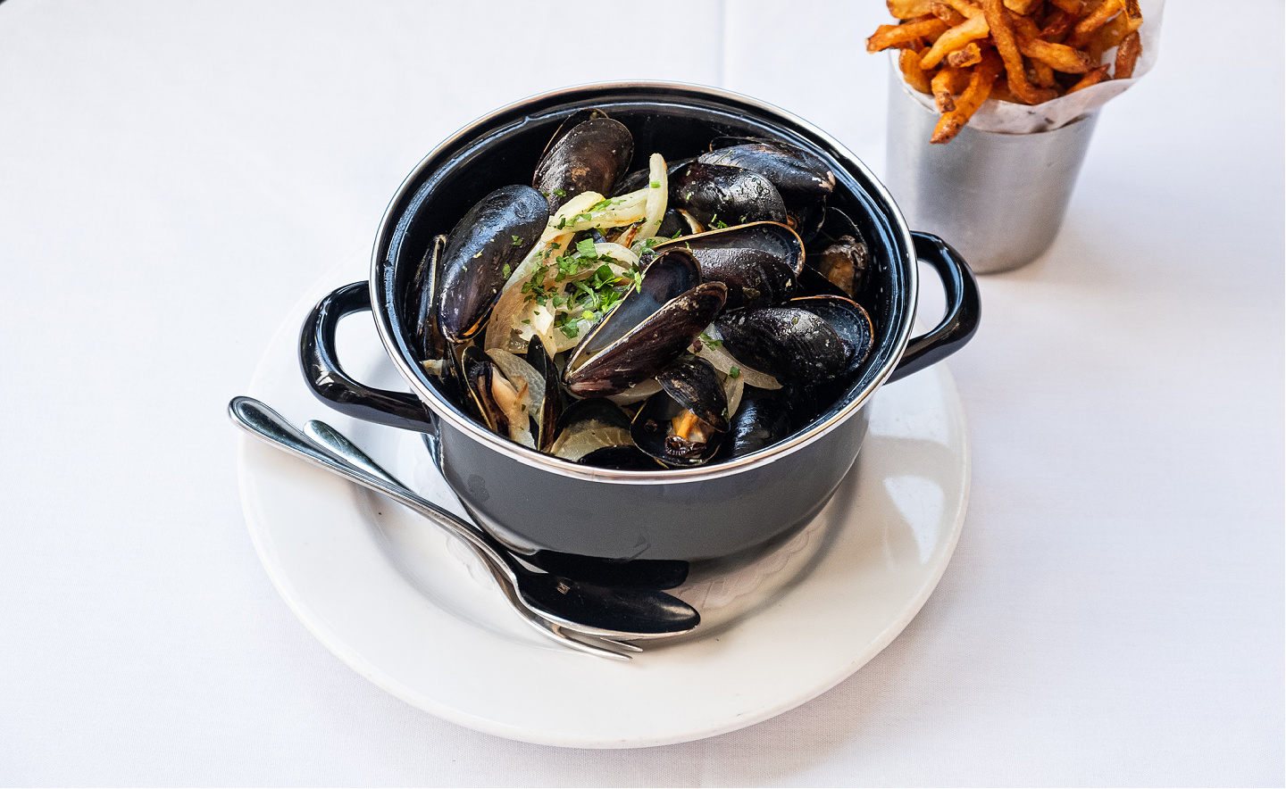 Pot of Mussels Mariniere with frites for Big Game Sunday at Mon Ami Gabi.