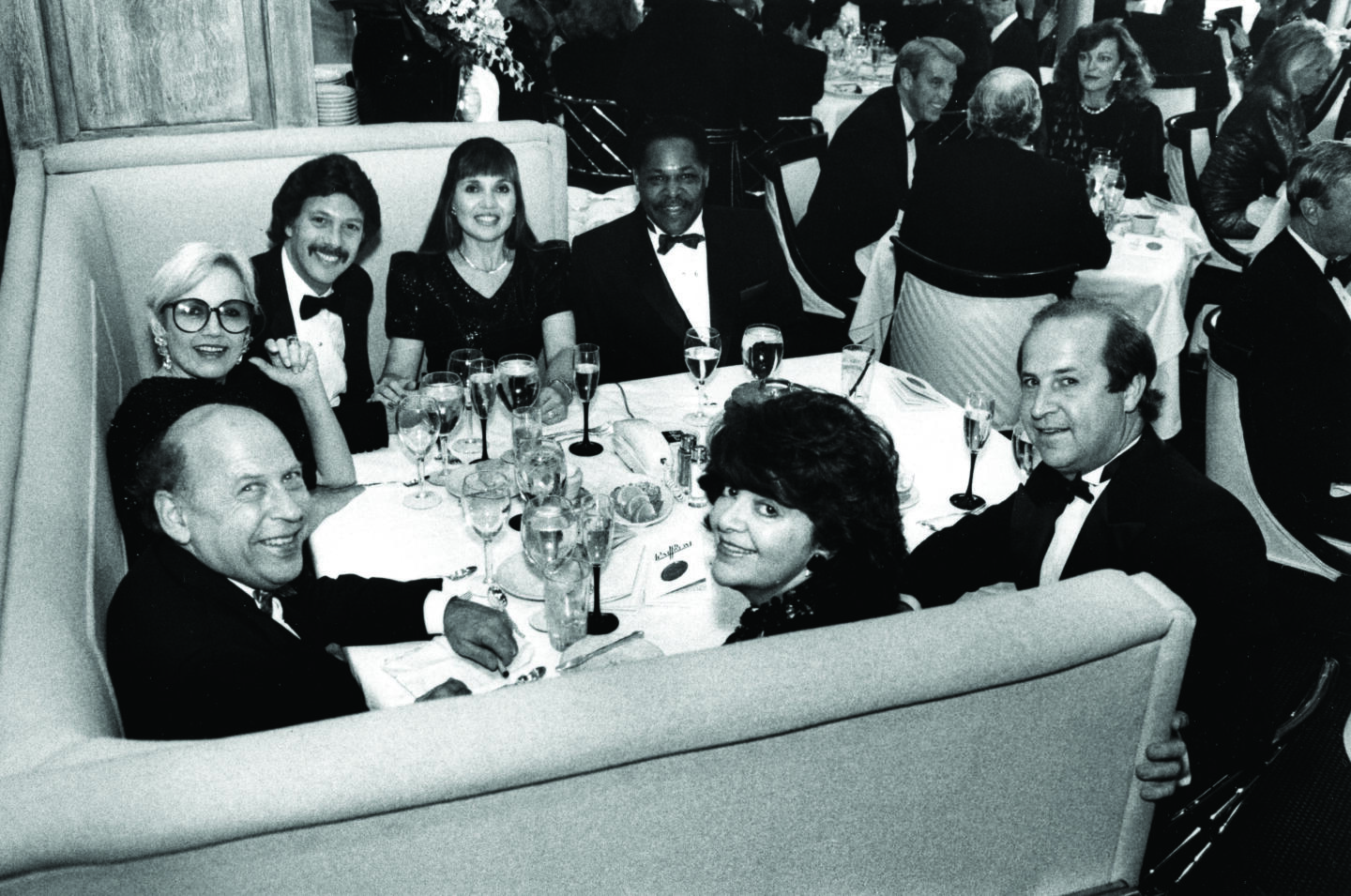 Richard and Martha Melman in Booth One at The Pump Room with baseball infielder Dave Nelson, Jane and Bernie Sahlins, Joyce Sloan and Danny Coval.