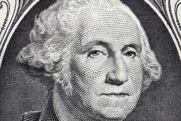 Macro detail of George Washington's face on the US one dollar bill.