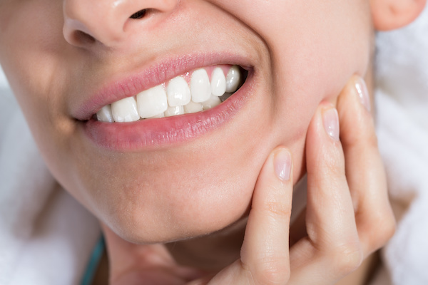 Closeup of young woman suffering from toothache at home