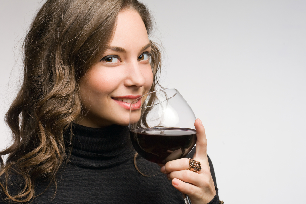 Cool fashionable young brunette woman tasting great wine.