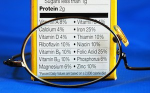 Nutrition facts from a box of food with eye glasses