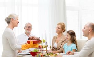 smiling family having dinner at home