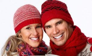 couple in winter attire smiling