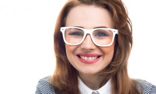 young girl with glass smiling