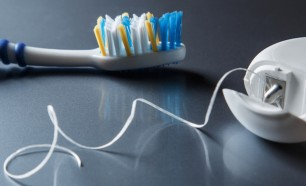 tooth brush and dental floss: flossing is very important to dental health