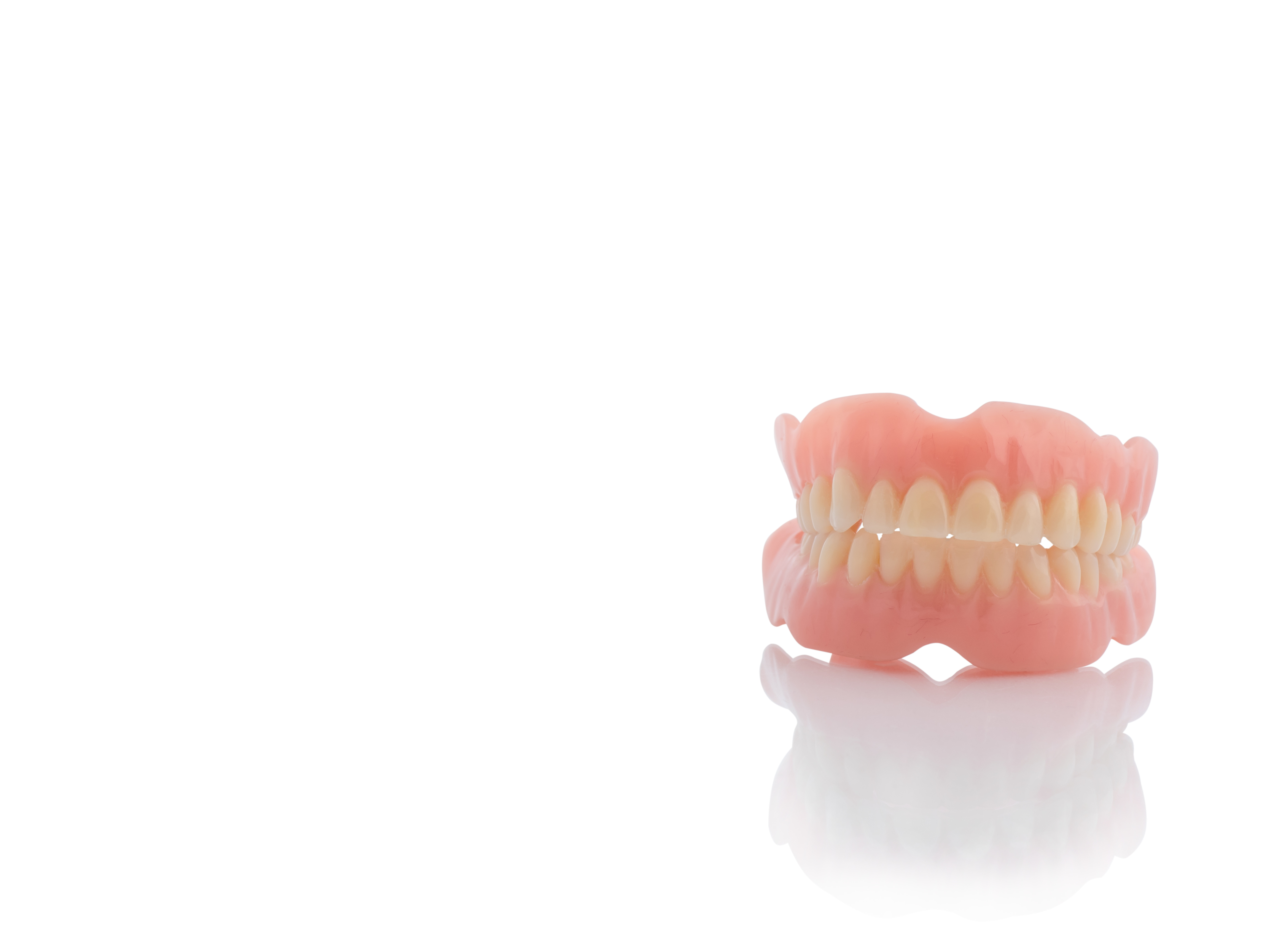 Pros and Cons of Dentures | Artistic Touch Dentistry