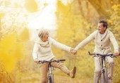 Healthy older couple, active, biking