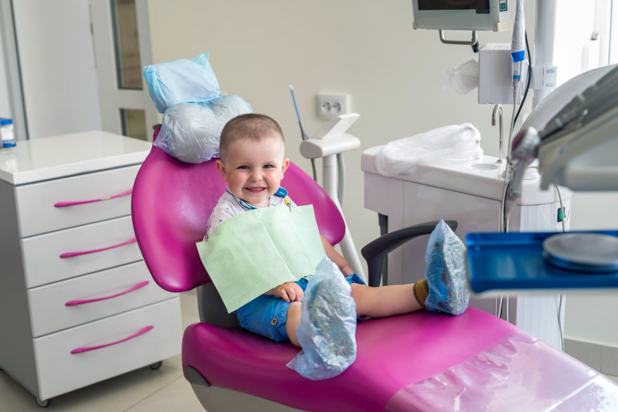 Little boy in dentistry, sitting in chair