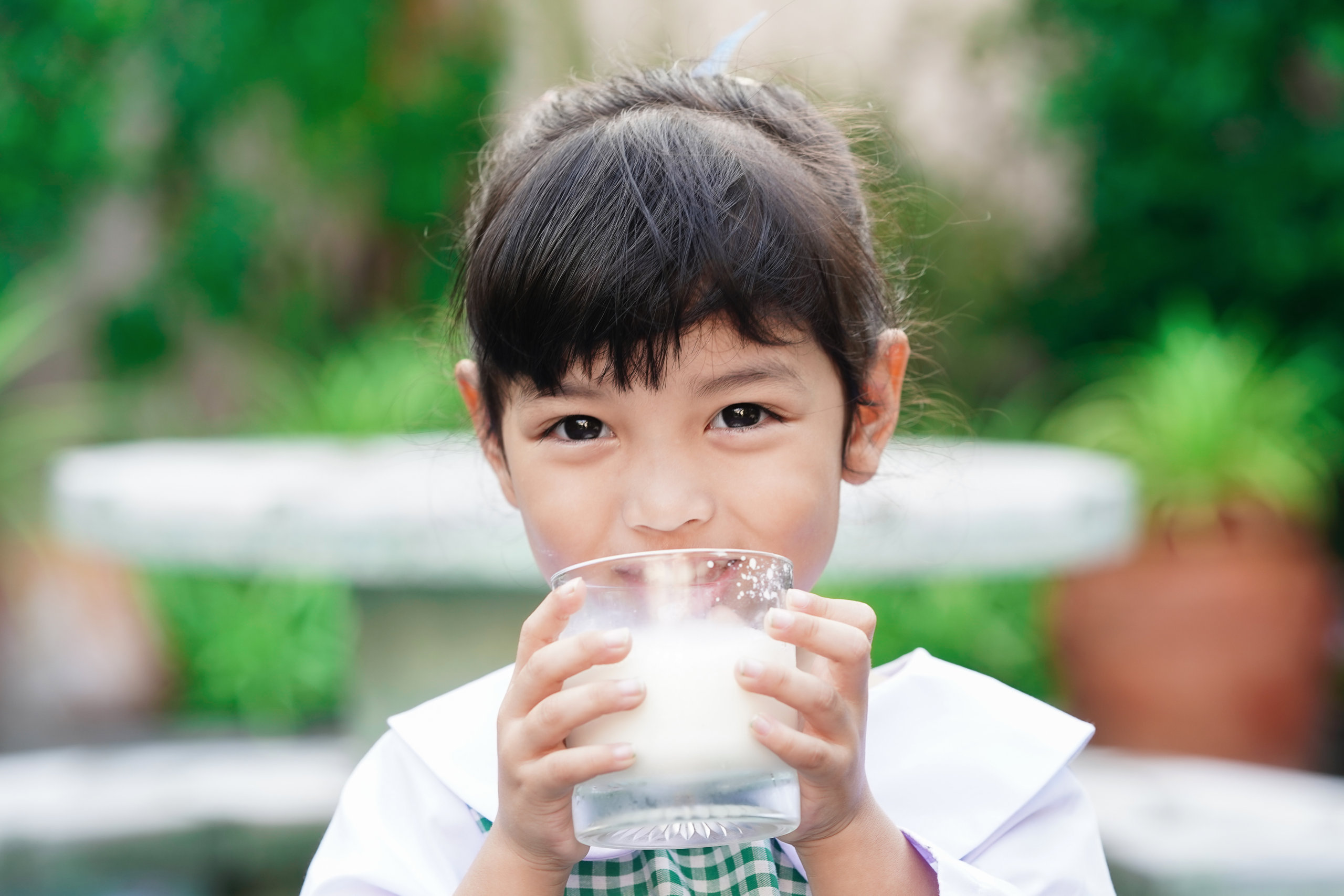 Young girl drinking milk