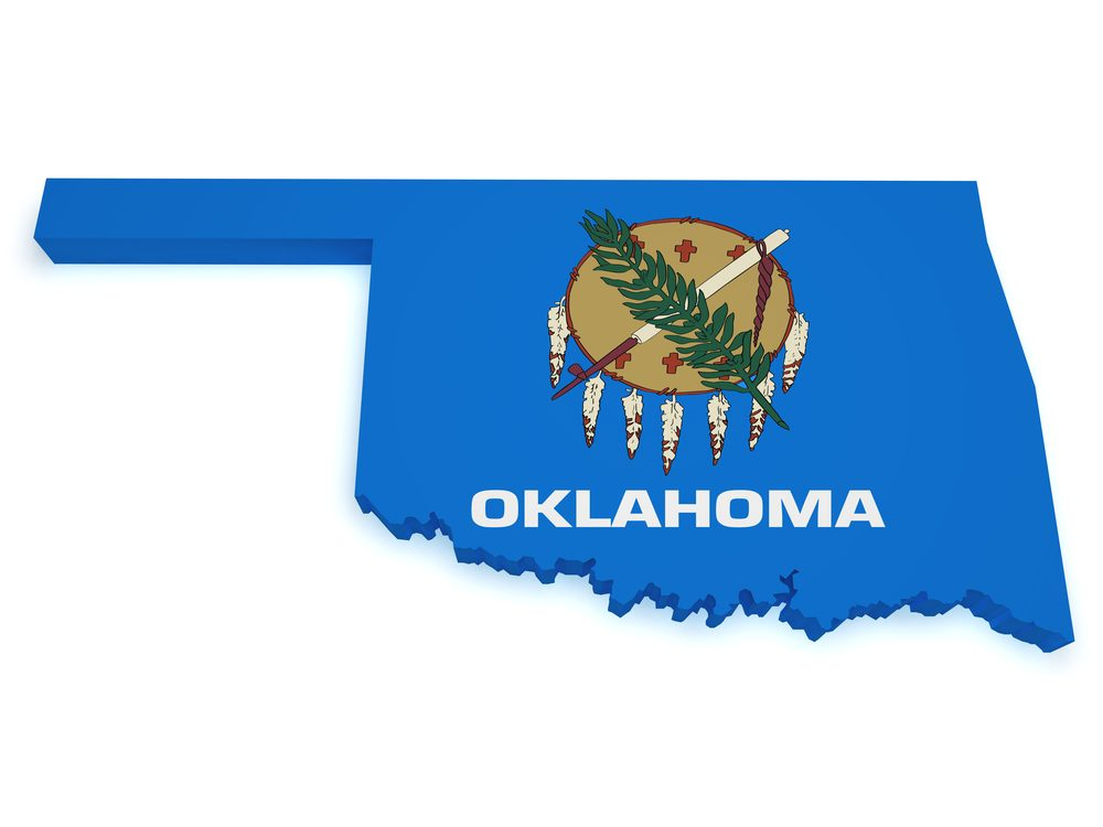 Shape 3d of Oklahoma map with flag isolated on white background.