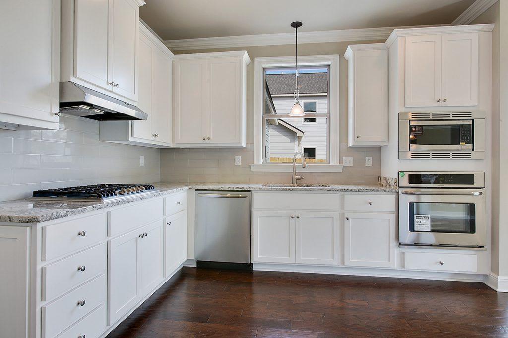 1450 Granada Drive Kitchen With Stainless Appliances, White Cabinets U0026  Subway Tile Backsplash