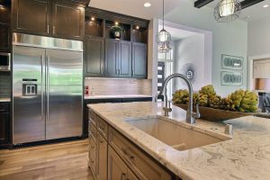 Gourmet Island with Quartz Countertop, Custom Storage, Undermount Sink and Pull-Down Faucet